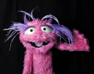 Mandy the pink fuzzy monster. Based on Project Puppet Mellon Head, made by John Arnold Holosite Puppets.